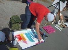 Andreas Mattern beim malen des Potsdamer Platzes
